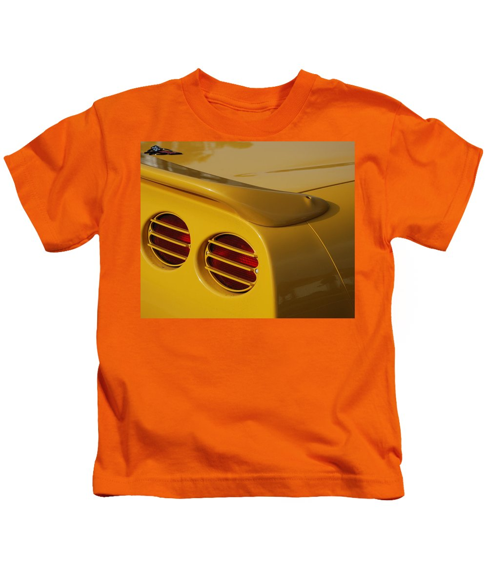 Corvette Kids T-Shirt featuring the photograph Yellow Vette Lights by Rob Hans