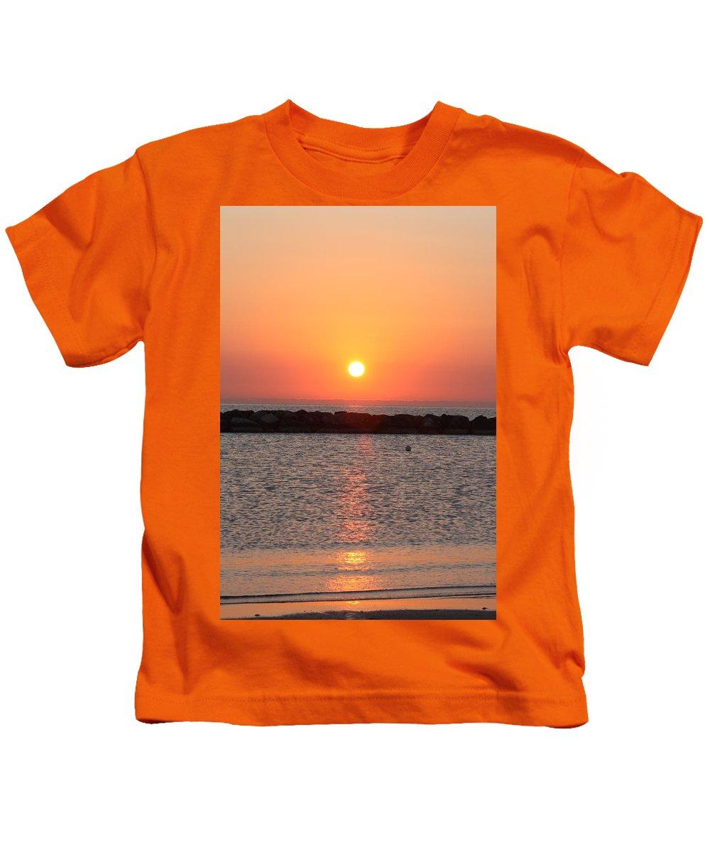 Alba Kids T-Shirt featuring the pyrography Alba Al Mare by Marcello Gennari