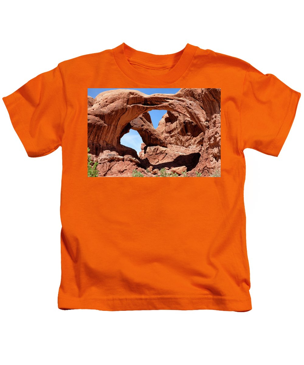 Arch Kids T-Shirt featuring the photograph Double Arch In Utah Park During Summer Time by Thomas Baker