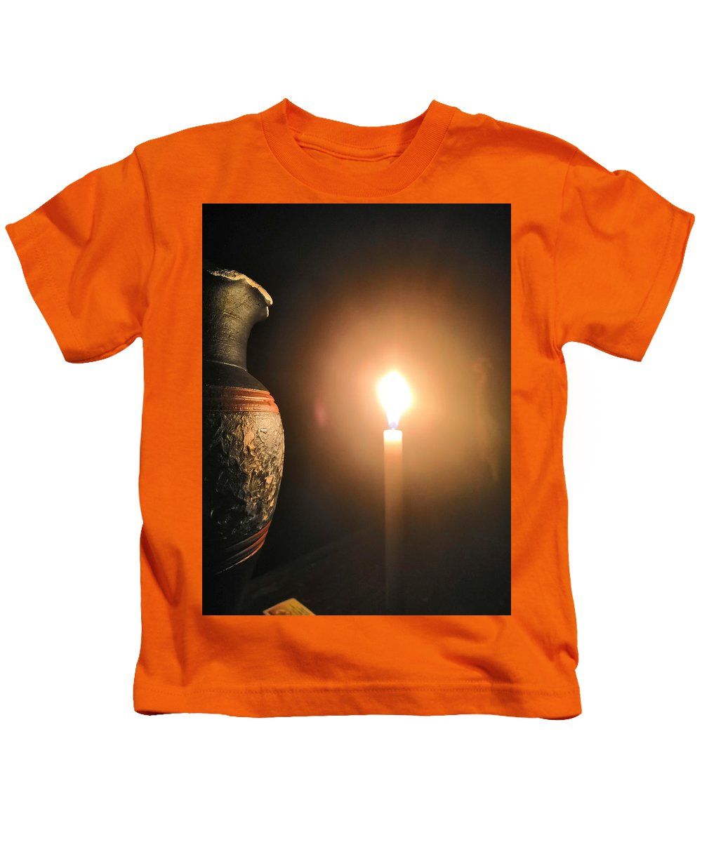 Candle Light Kids T-Shirt featuring the photograph Light in the dark by Ian Batanda