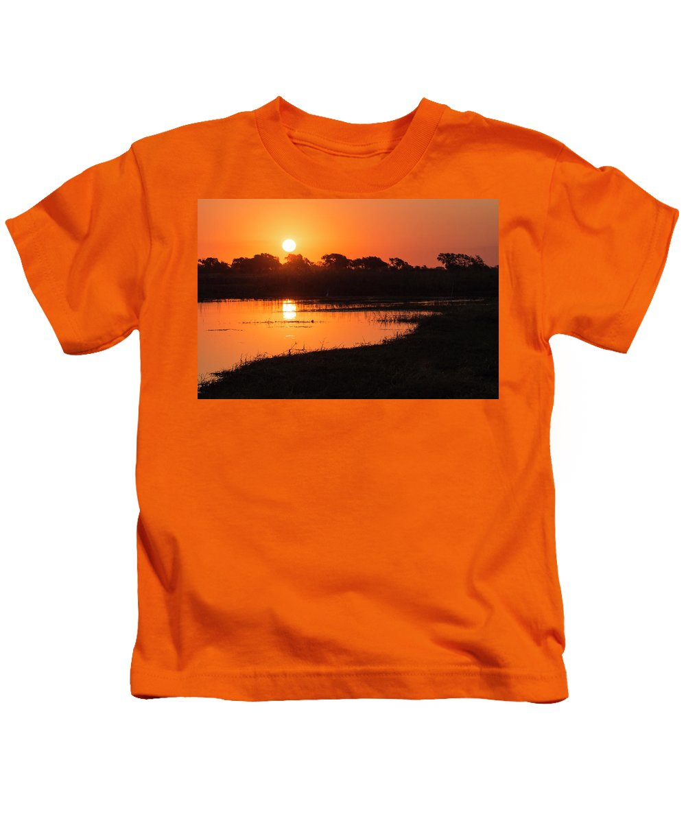 Sunset Kids T-Shirt featuring the photograph Sunset On The Chobe River by Claudio Maioli