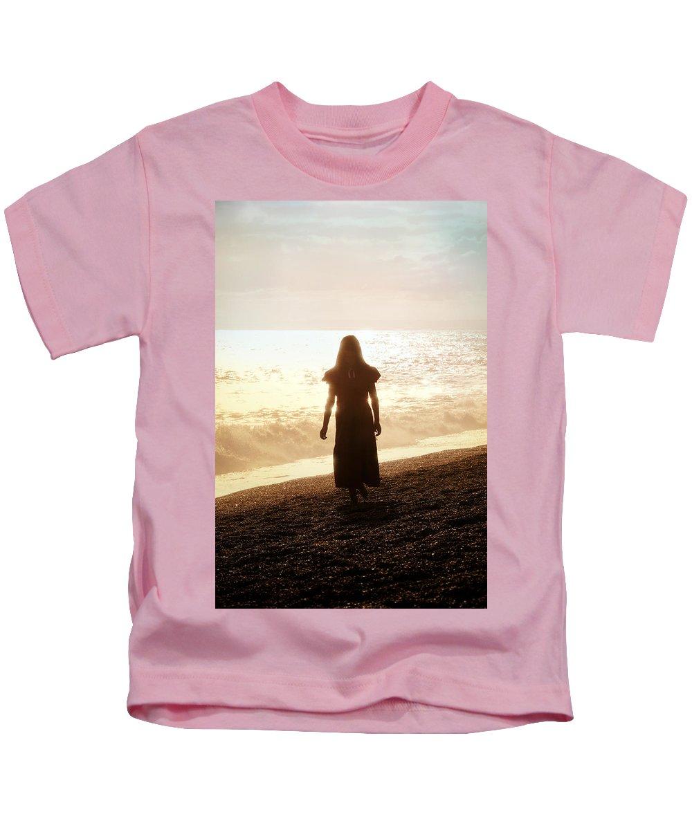 Girl Kids T-Shirt featuring the photograph Girl On Beach by Joana Kruse