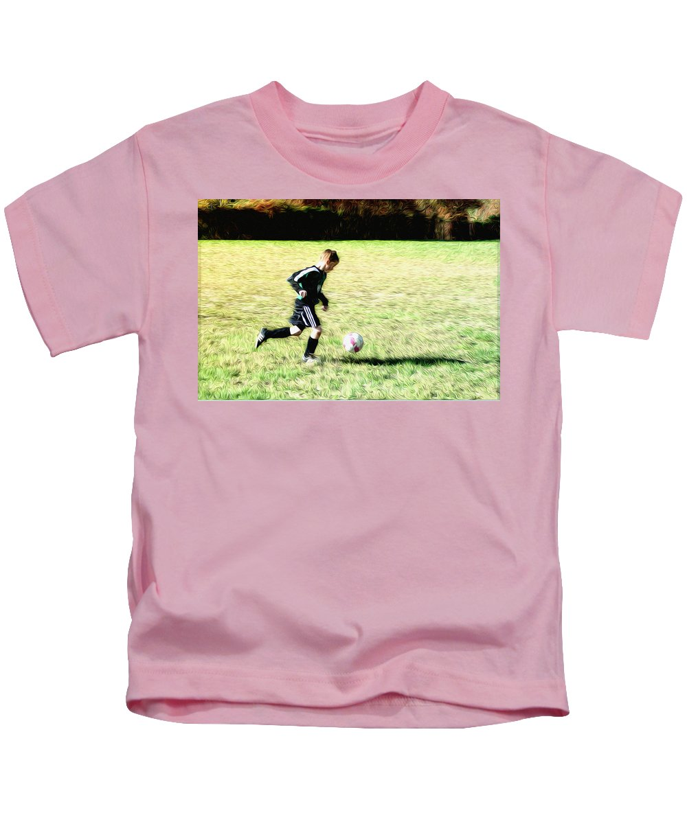 Footballer Kids T-Shirt featuring the photograph Footballer by Bill Cannon