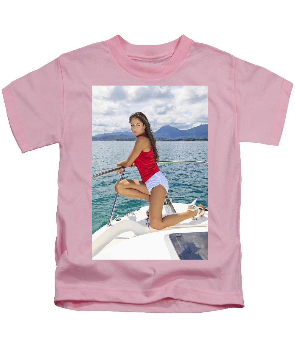 Attractive Kids T-Shirt featuring the photograph Woman Boating At Kaneohe by Tomas del Amo - Printscapes