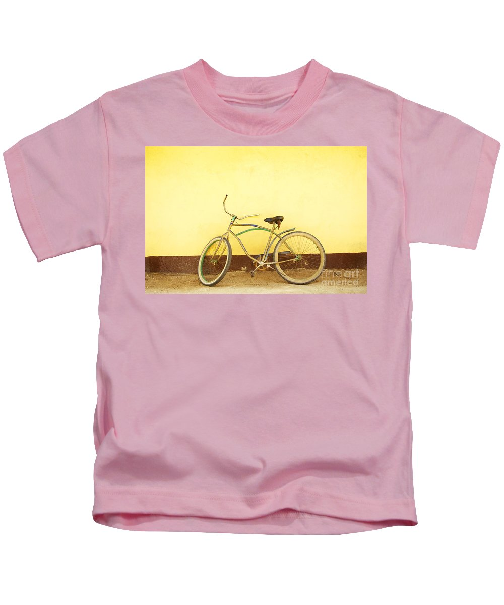Bicycle Kids T-Shirt featuring the photograph Bike And Yellow Wall by Kyle Rothenborg - Printscapes