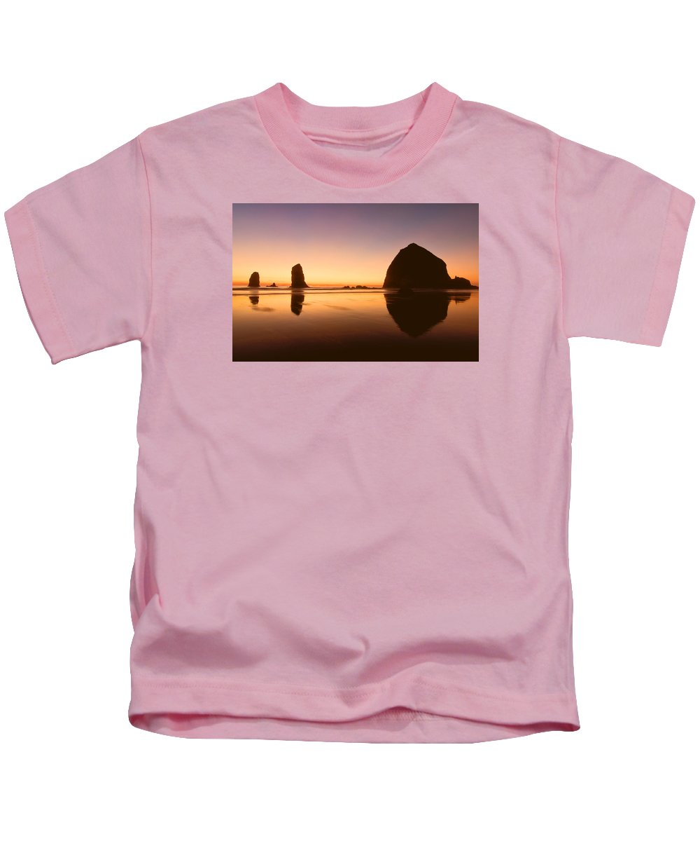 Cannon Beach Kids T-Shirt featuring the photograph Nightfall At Cannon Beach Oregon by Don Schwartz