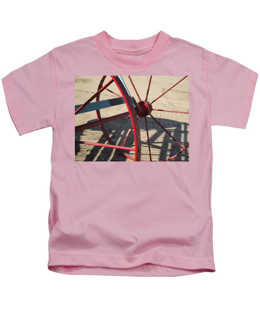 Wheel Kids T-Shirt featuring the photograph Red Waggon Wheel by Susan Baker