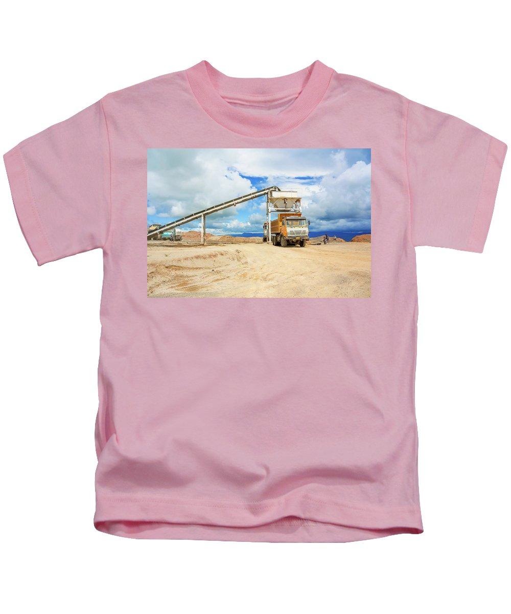 Tanzania Kids T-Shirt featuring the photograph Truck Loading Gravel In Tabnzania. by Marek Poplawski