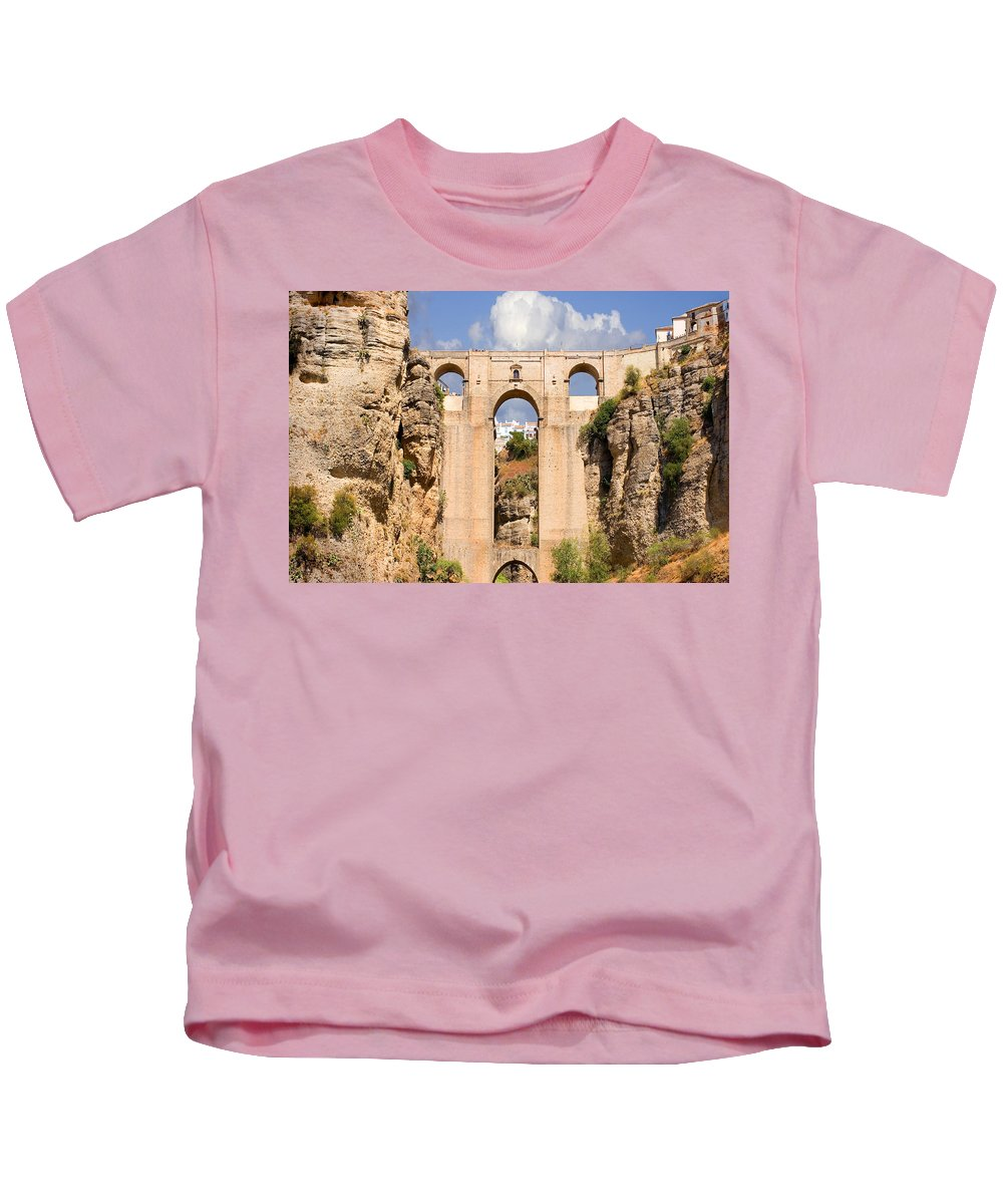 Ronda Kids T-Shirt featuring the photograph View Of The Tajo De Ronda And The Puente Nuevo Bridge From Across The Valley by Mal Bray