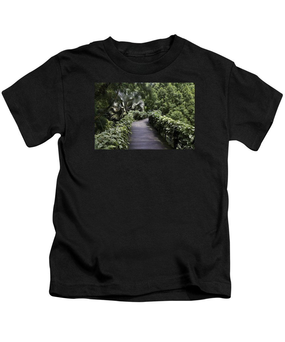 Asia Kids T-Shirt featuring the photograph A Raised Walking Path Inside The National Orchid Garden In Singapore by Ashish Agarwal