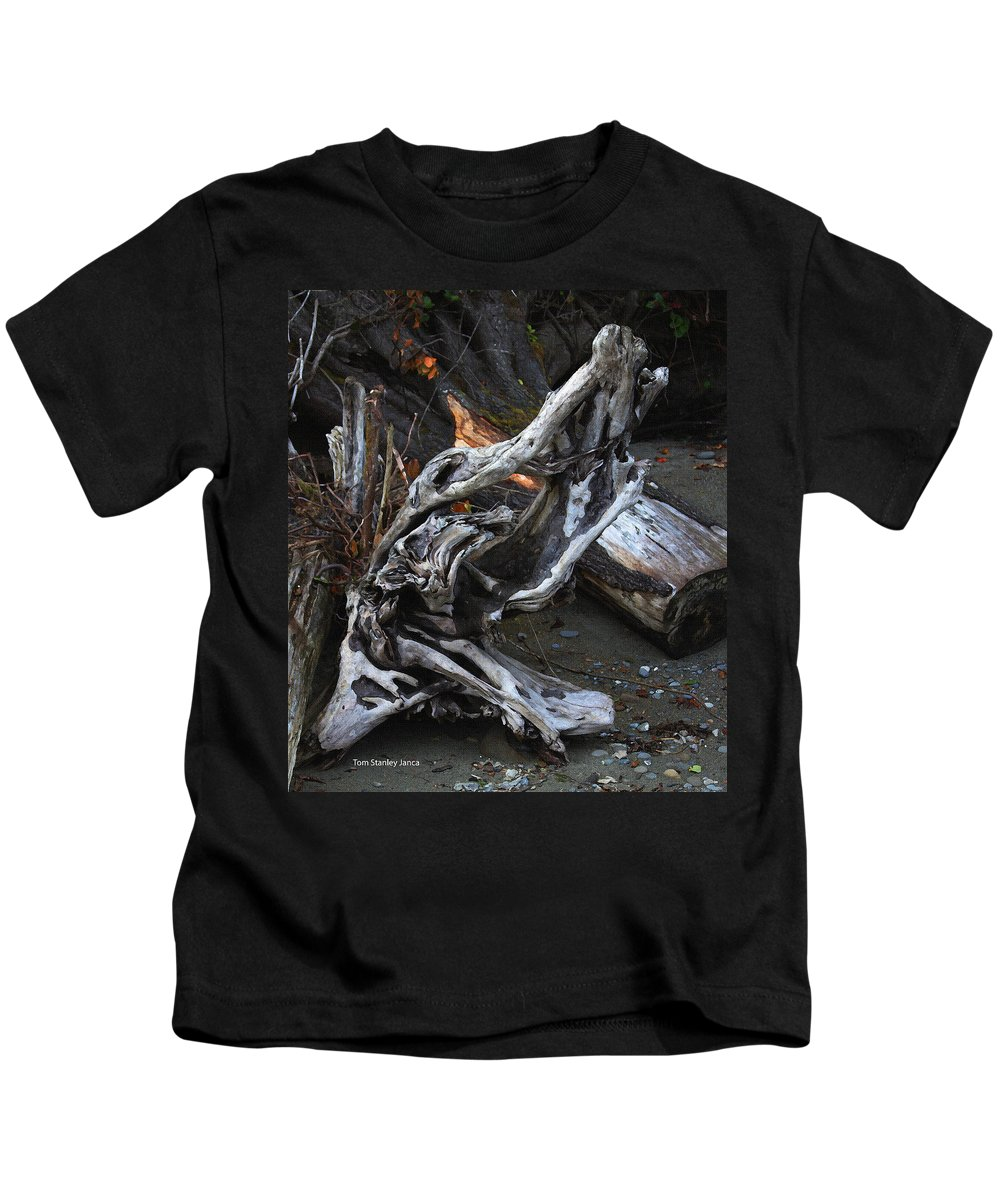 Driftwood On The Beach Kids T-Shirt featuring the photograph Driftwood On The Beach by Tom Janca