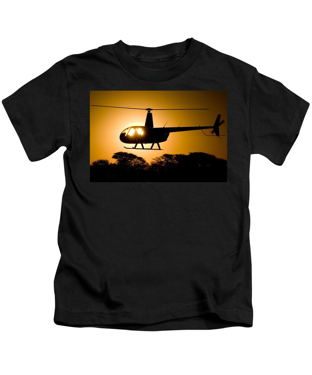 Helicopter Kids T-Shirt featuring the photograph R44 Sunset by Paul Job