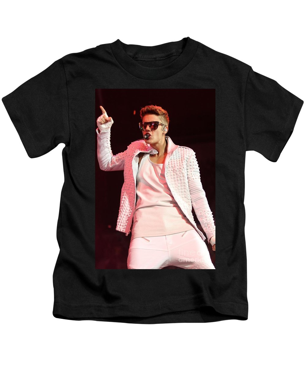 Performing Kids T-Shirt featuring the photograph Singer Justin Bieber by Concert Photos