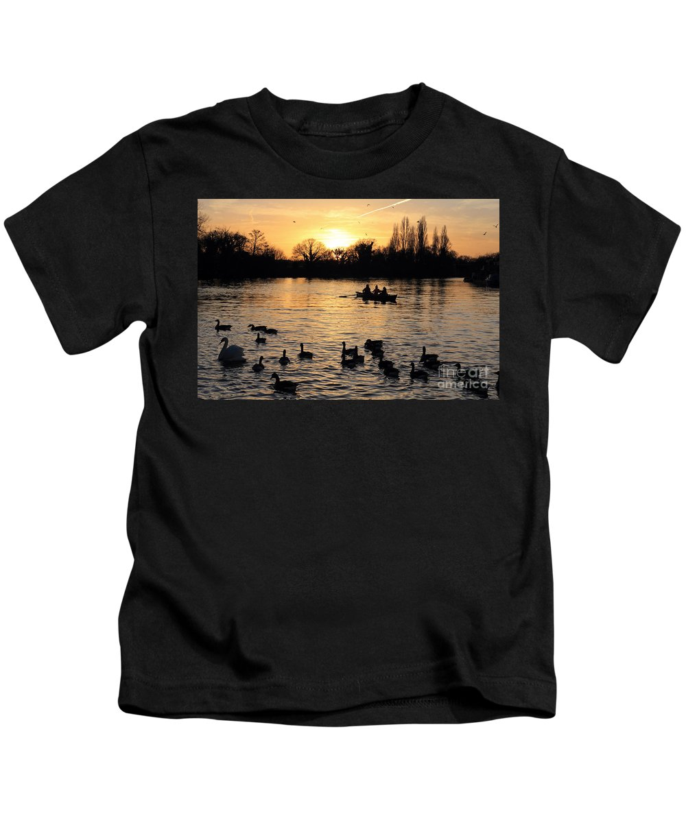 Rowing Boat Swans Ducks Sunset On The Thames At Walton Spectacular Surrey Uk Dusk Sky Twilight Trees Silhouette Orange Sun Set Down English England Branches Lone Ducks Swans Geese Duck Swan Glow Calm Water Tranquil River Feeding Kids T-Shirt featuring the photograph Sunset On The Thames At Walton by Julia Gavin
