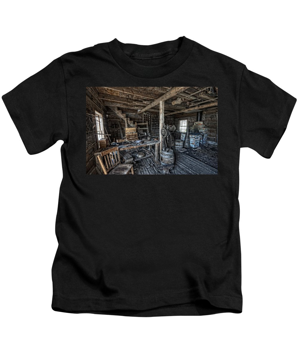 Blacksmith Kids T-Shirt featuring the photograph 1860's Blacksmith Shop - Nevada City Ghost Town - Montana by Daniel Hagerman