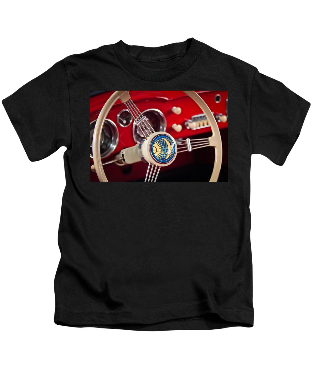 1956 Volkswagen Karmann Ghia Coupe Steering Wheel Emblem Kids T-Shirt featuring the photograph 1956 Volkswagen Vw Karmann Ghia Coupe Steering Wheel 2 by Jill Reger