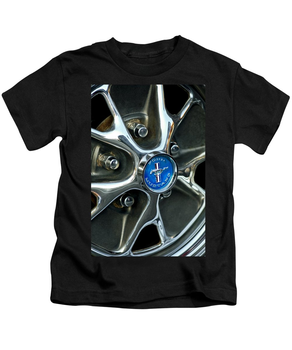 1965 Ford Mustang Emblem Kids T-Shirt featuring the photograph 1965 Ford Mustang Wheel Rim by Jill Reger