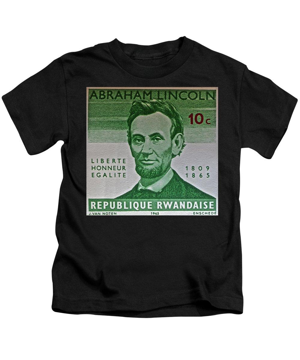 1965 Rwanda Abraham Lincoln Stamp Kids T-Shirt featuring the photograph 1965 Rwanda Abraham Lincoln Stamp by Bill Owen