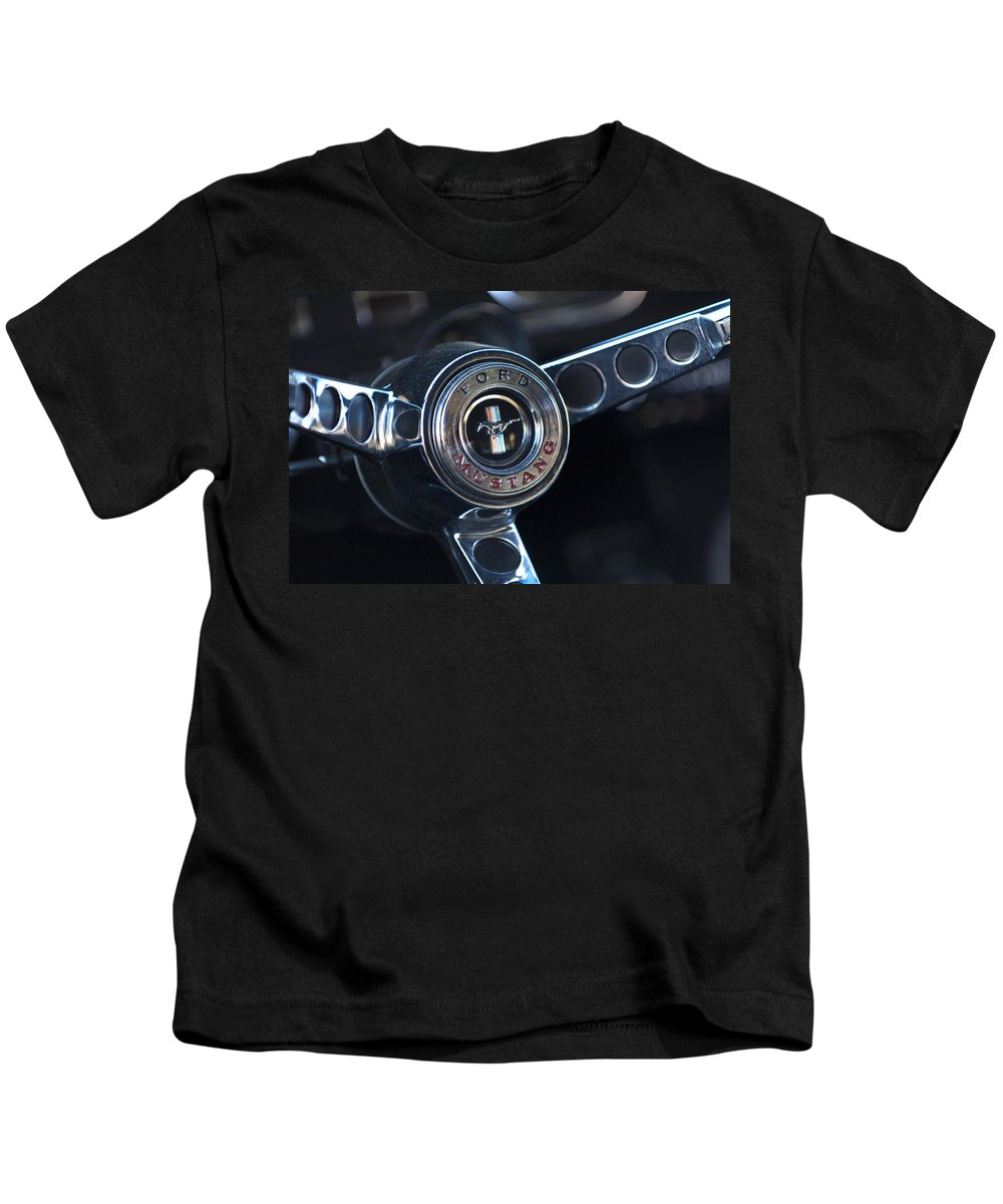 1965 Shelby Prototype Ford Mustang Steering Wheel Kids T-Shirt featuring the photograph 1965 Shelby Prototype Ford Mustang Steering Wheel Emblem -0356c by Jill Reger