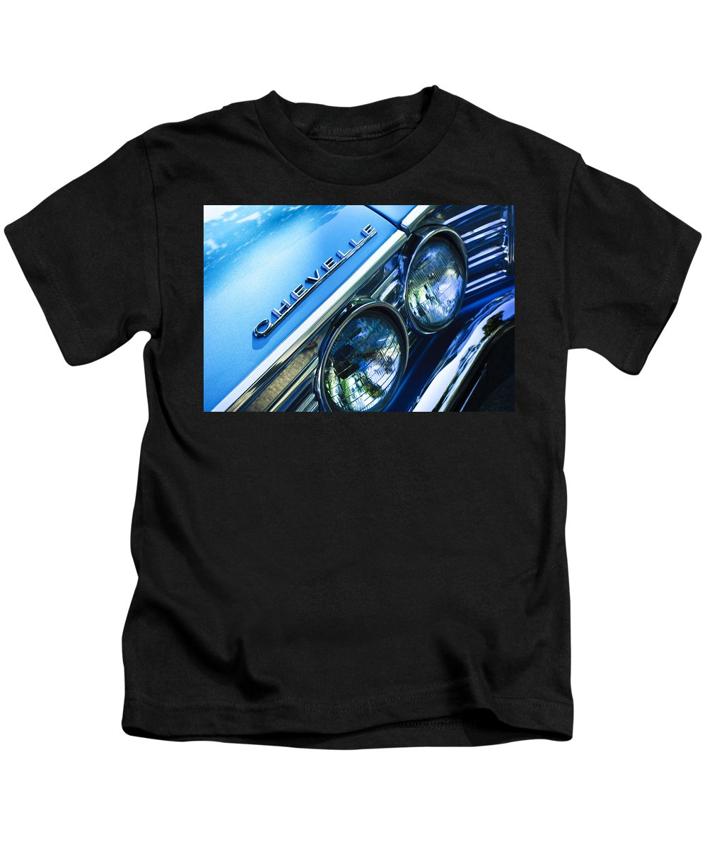 1967 Chevrolet Chevelle Malibu Head Light Emblem Kids T-Shirt featuring the photograph 1967 Chevrolet Chevelle Malibu Head Light Emblem by Jill Reger