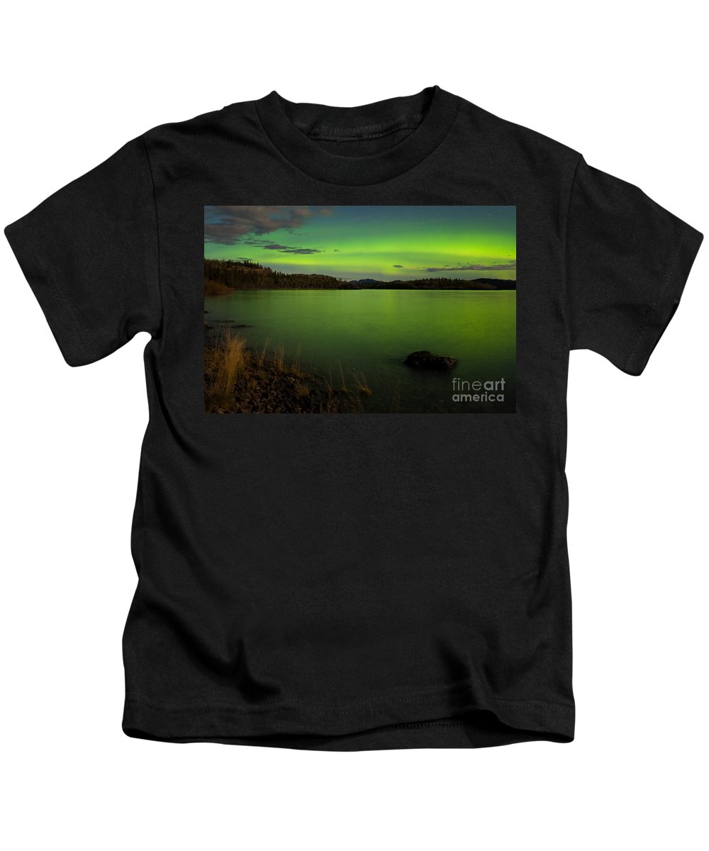 Above Kids T-Shirt featuring the photograph Aurora Borealis Northern Lights Display by Stephan Pietzko