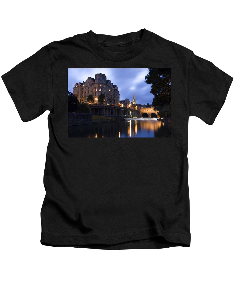 Bath Kids T-Shirt featuring the photograph Bath City Spa Viewed Over The River Avon At Night by Mal Bray