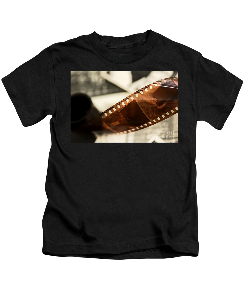 35mm Kids T-Shirt featuring the photograph Old Film Strip And Photos Background by Michal Bednarek