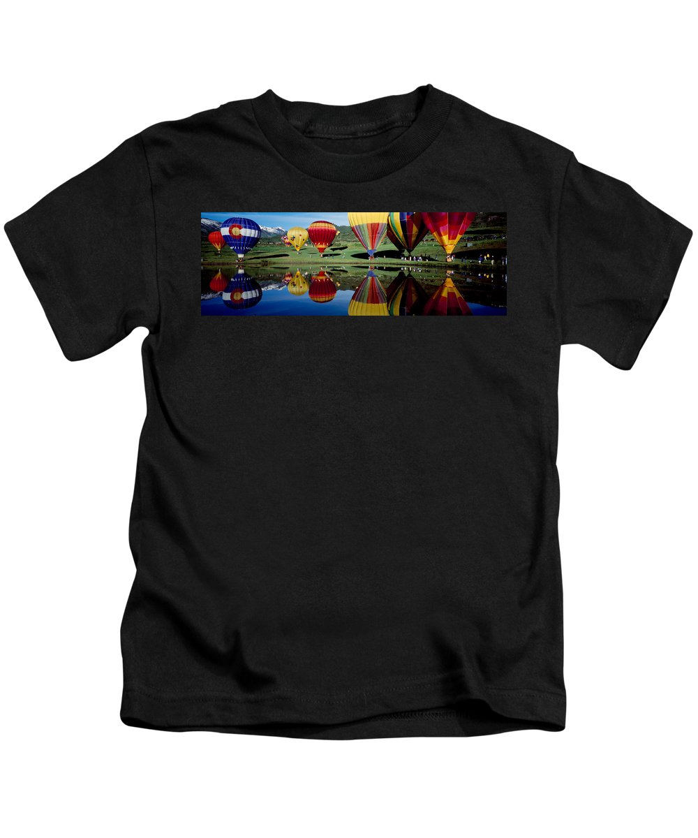 Photography Kids T-Shirt featuring the photograph Reflection Of Hot Air Balloons by Panoramic Images