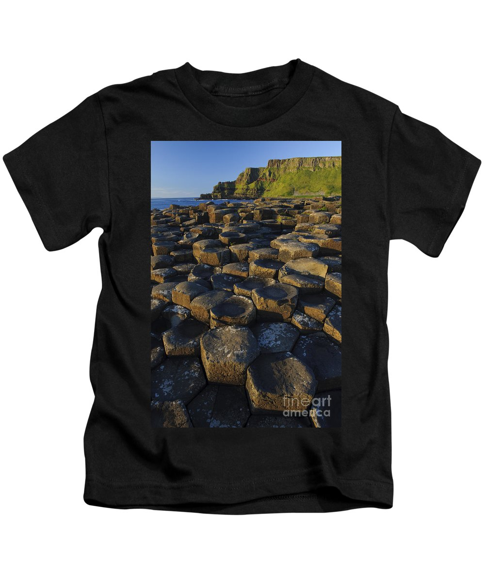 Landscape Kids T-Shirt featuring the photograph The Giants Causeway by John Shaw