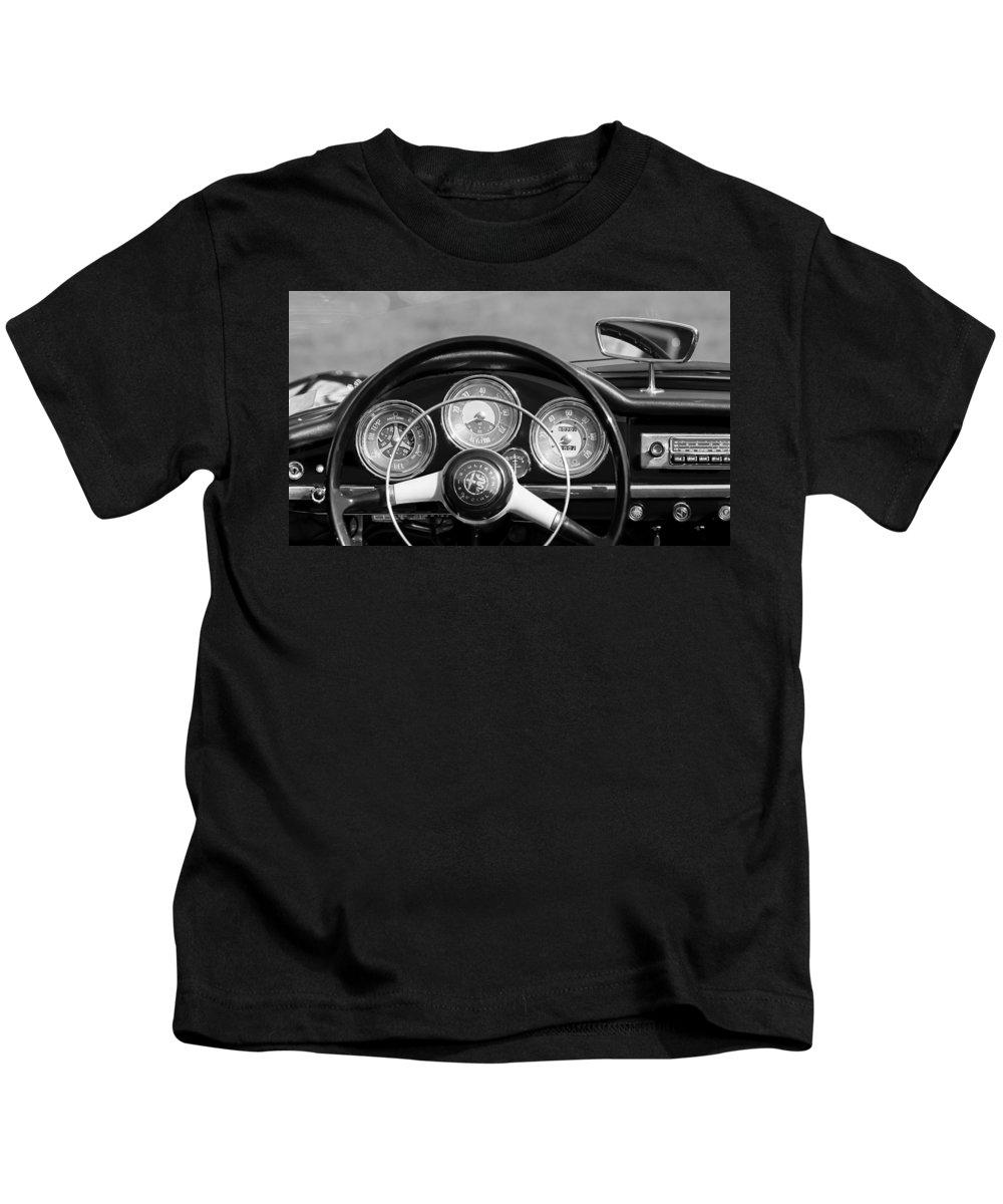 1961 Alfa-romeo Giulietta Spider Steering Wheel Emblem Kids T-Shirt featuring the photograph 1961 Alfa Romeo Giulietta Spider Steering Wheel Emblem -1185bw by Jill Reger