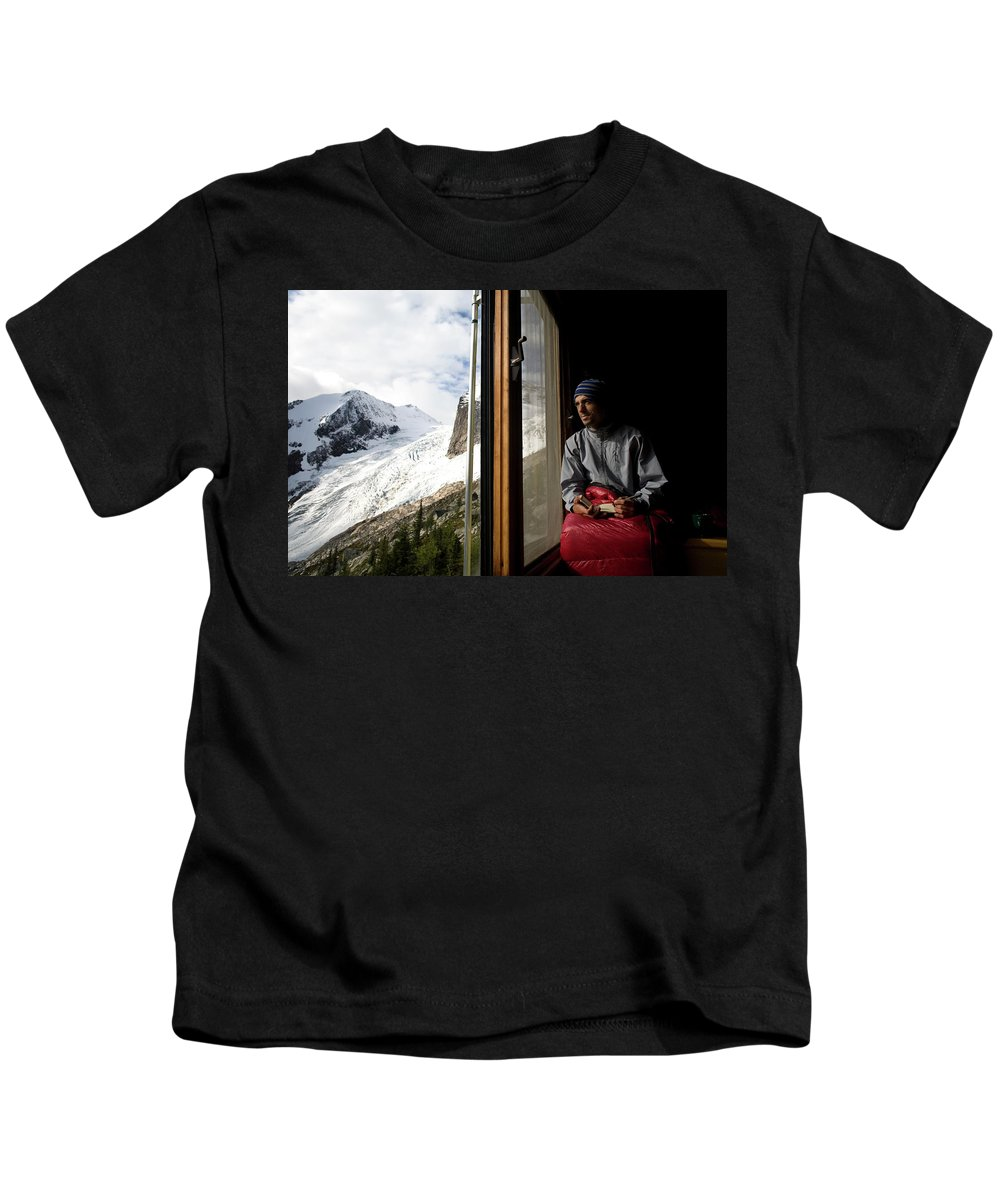 Beanie Kids T-Shirt featuring the photograph A Man Writes In His Journal, While by Aaron Black