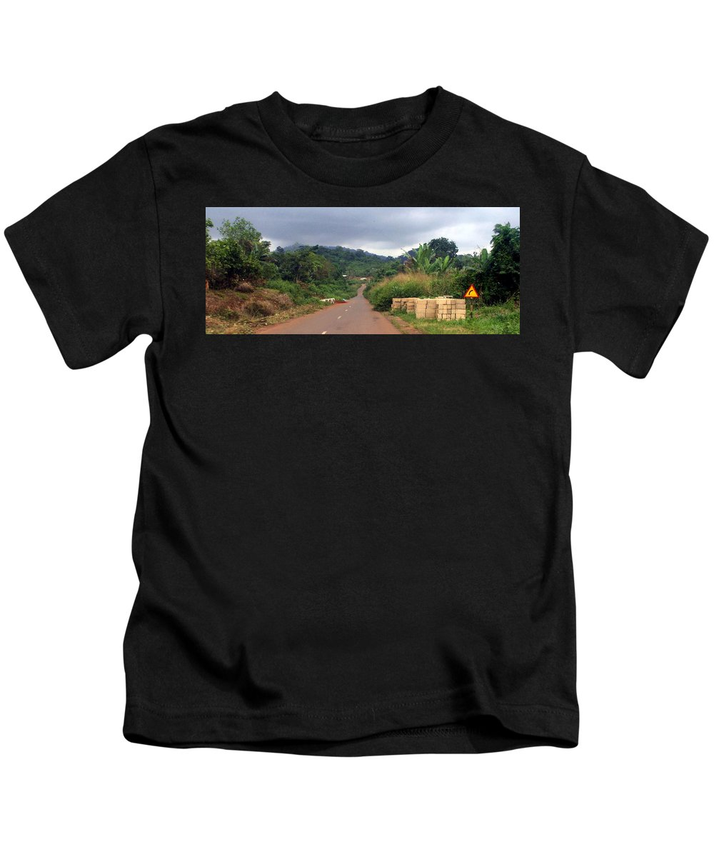 Travel Kids T-Shirt featuring the photograph A Nice Nigerian Road by Amy Hosp