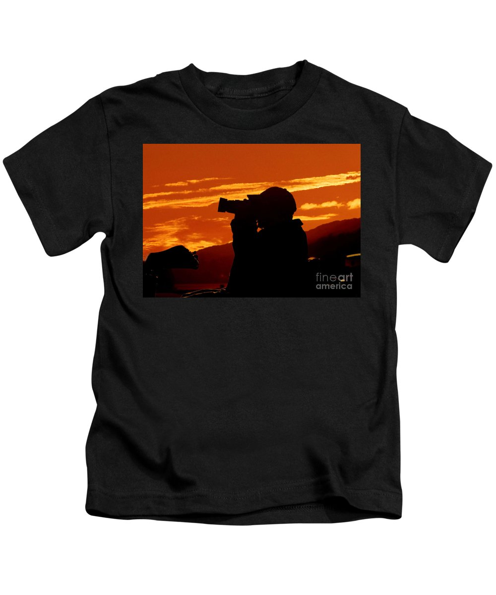 Sunset Kids T-Shirt featuring the photograph A Photographer Enjoying His Work by Kathy Baccari