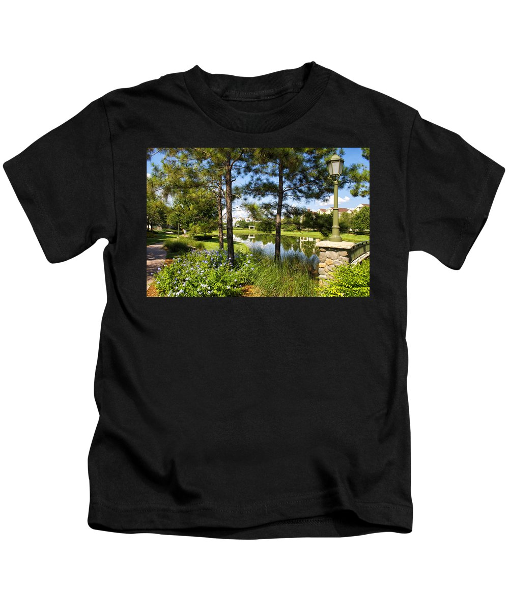 Pond Kids T-Shirt featuring the photograph A Tranquil Pond At Walt Disney World by Thomas Woolworth