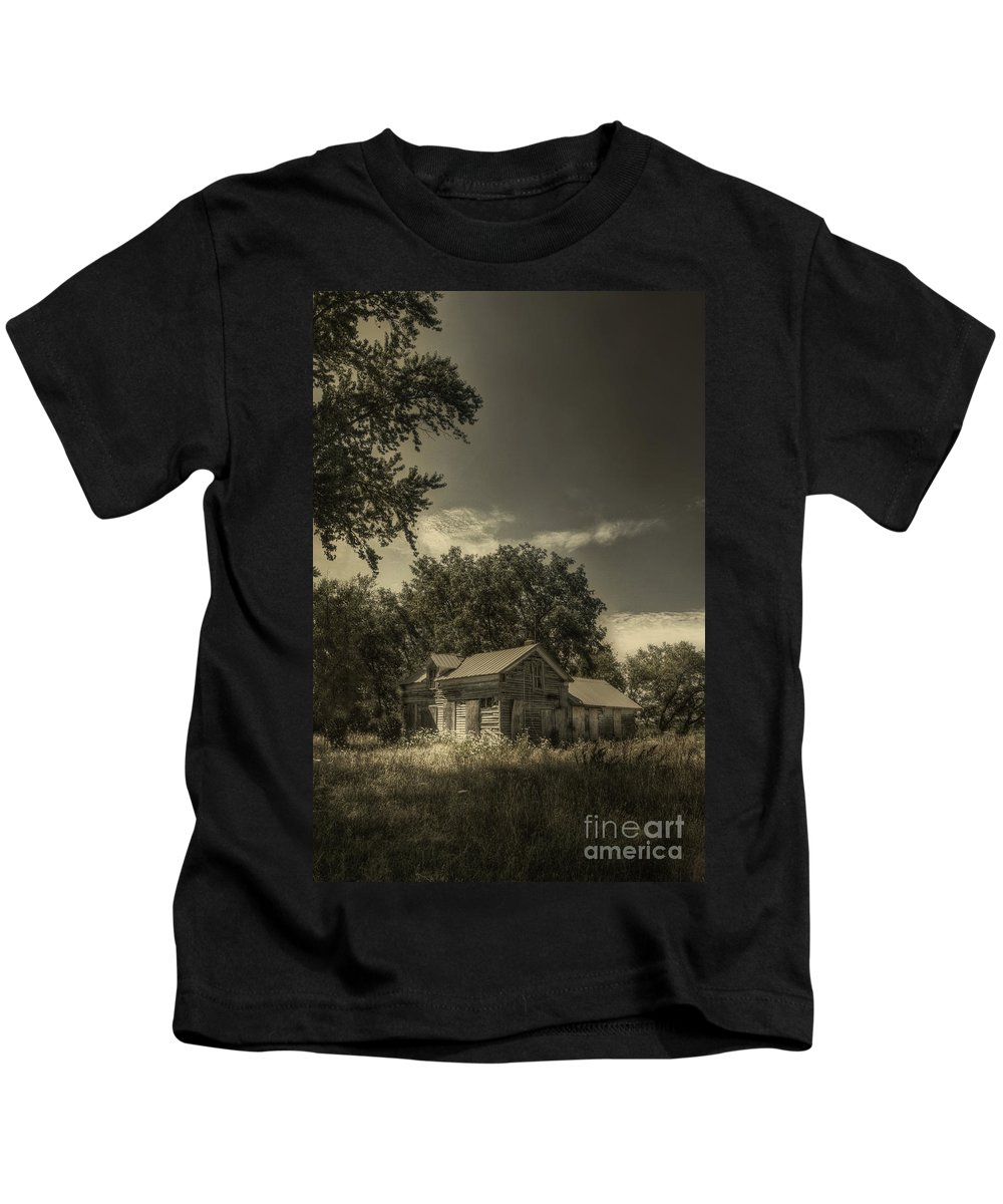 House; Home; Small; Farm House; Boarded; Boards; Wood; Falling Apart; Weeds; Grasses; Trees; Secluded; Abandoned; Desolate; Closed; Dark; Darkness; Ominous; Foreboding; Mystery; Mysterious; Deserted Kids T-Shirt featuring the photograph Abandoned Homestead by Margie Hurwich