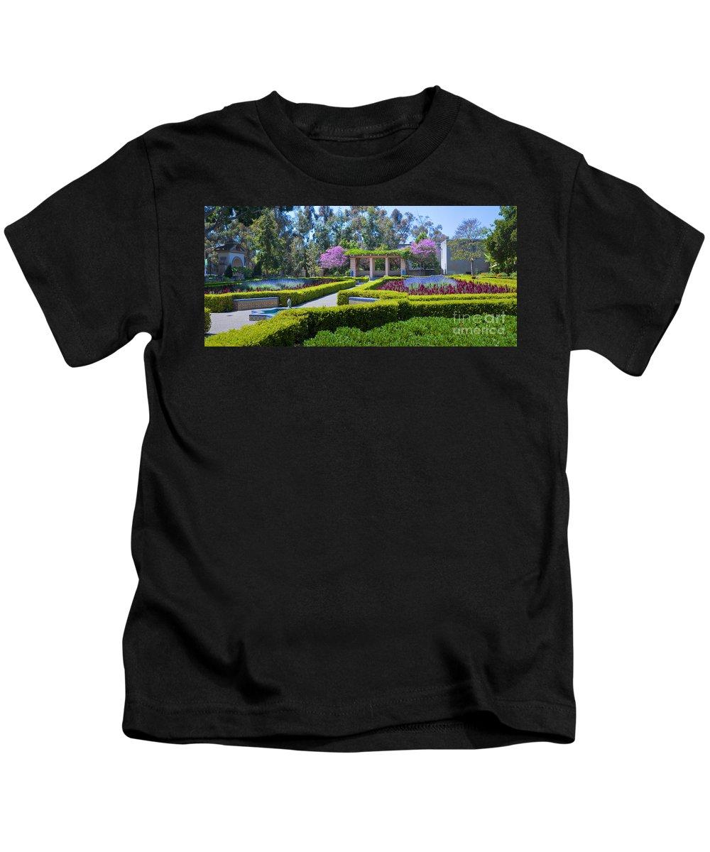 Alcazar Garden Kids T-Shirt featuring the photograph Alcazar Garden Vibrant Color Display Balboa Park by David Zanzinger