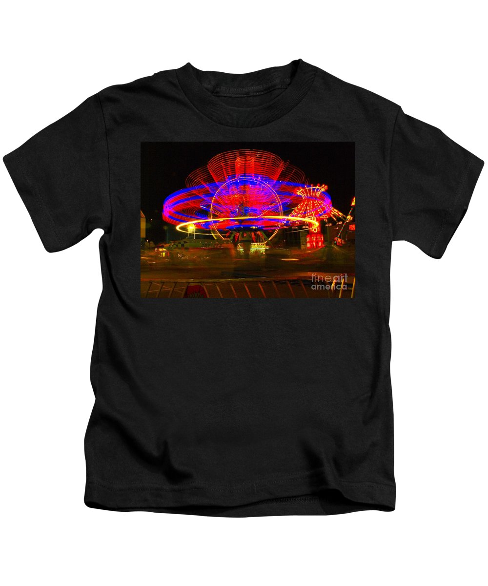 Night Photos Kids T-Shirt featuring the photograph All The Rides Moving At Once by Jeff Swan
