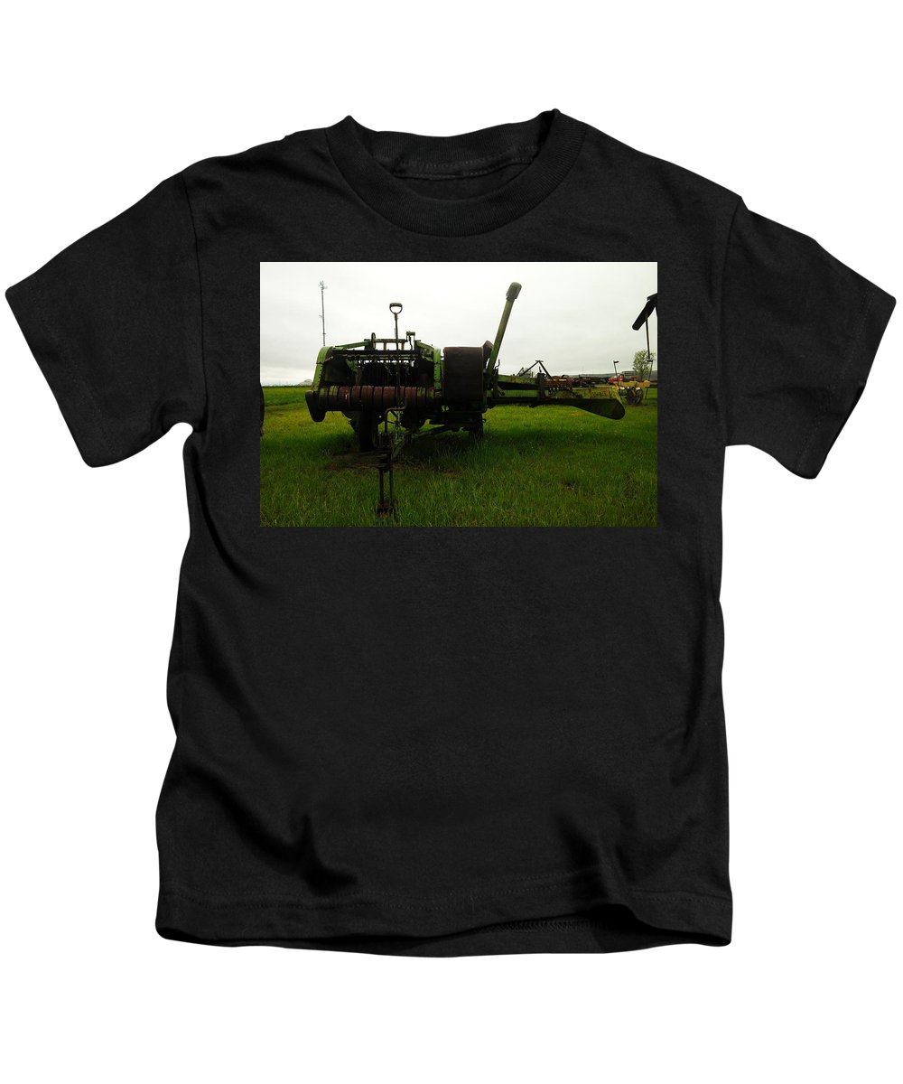 Farm Equipment Kids T-Shirt featuring the photograph An Old Bailor by Jeff Swan