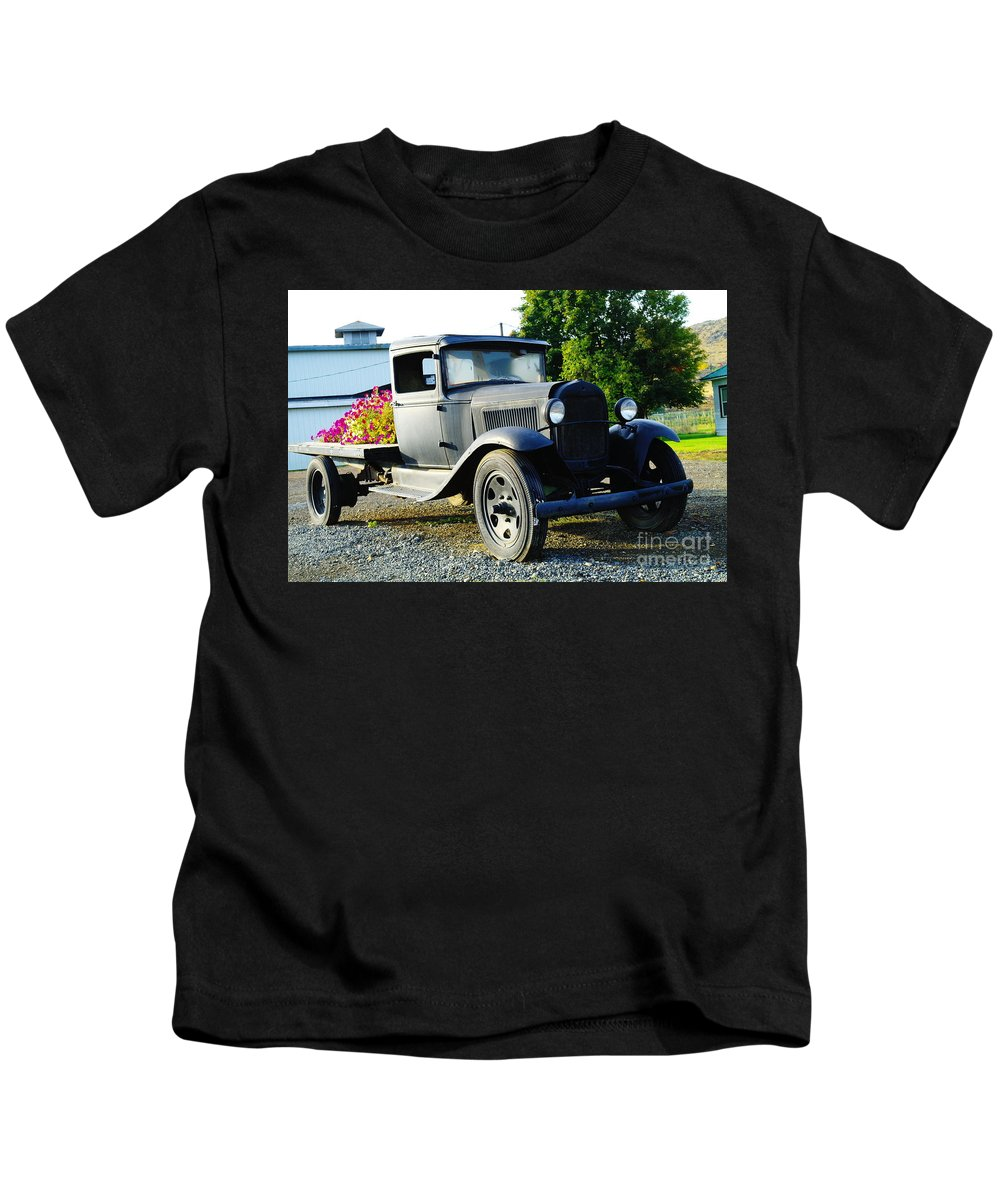 Old Trucks Kids T-Shirt featuring the photograph An Old Farm Truck by Jeff Swan