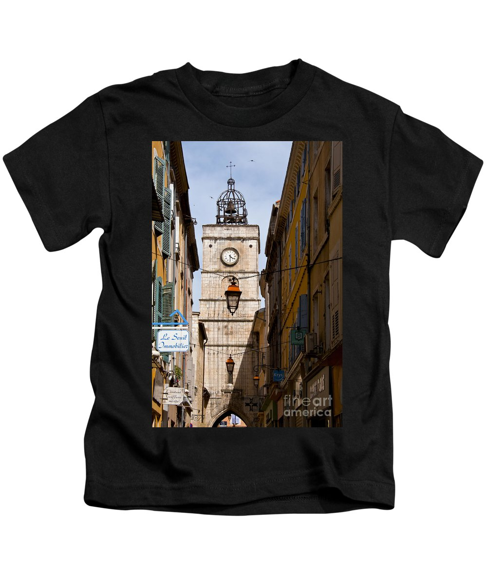 Apt France Bell Tower Towers City Cities Signs Sign City Street Light Lights Streets Cityscape Cityscapes Provence Kids T-Shirt featuring the photograph Apt Bell Tower by Bob Phillips