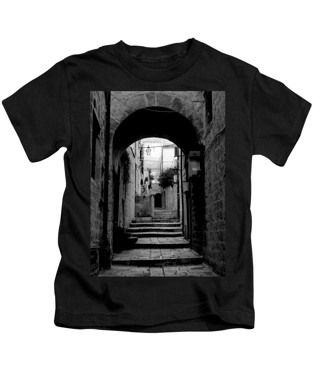Dubrovnik. Croatia Kids T-Shirt featuring the photograph Arch Walkway by Richard Rosenshein