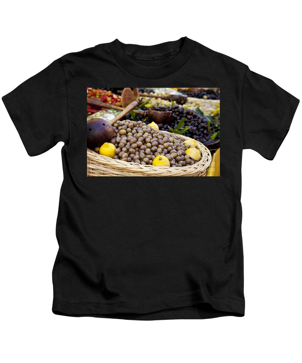Olive Kids T-Shirt featuring the photograph At The Market by Brian Jannsen