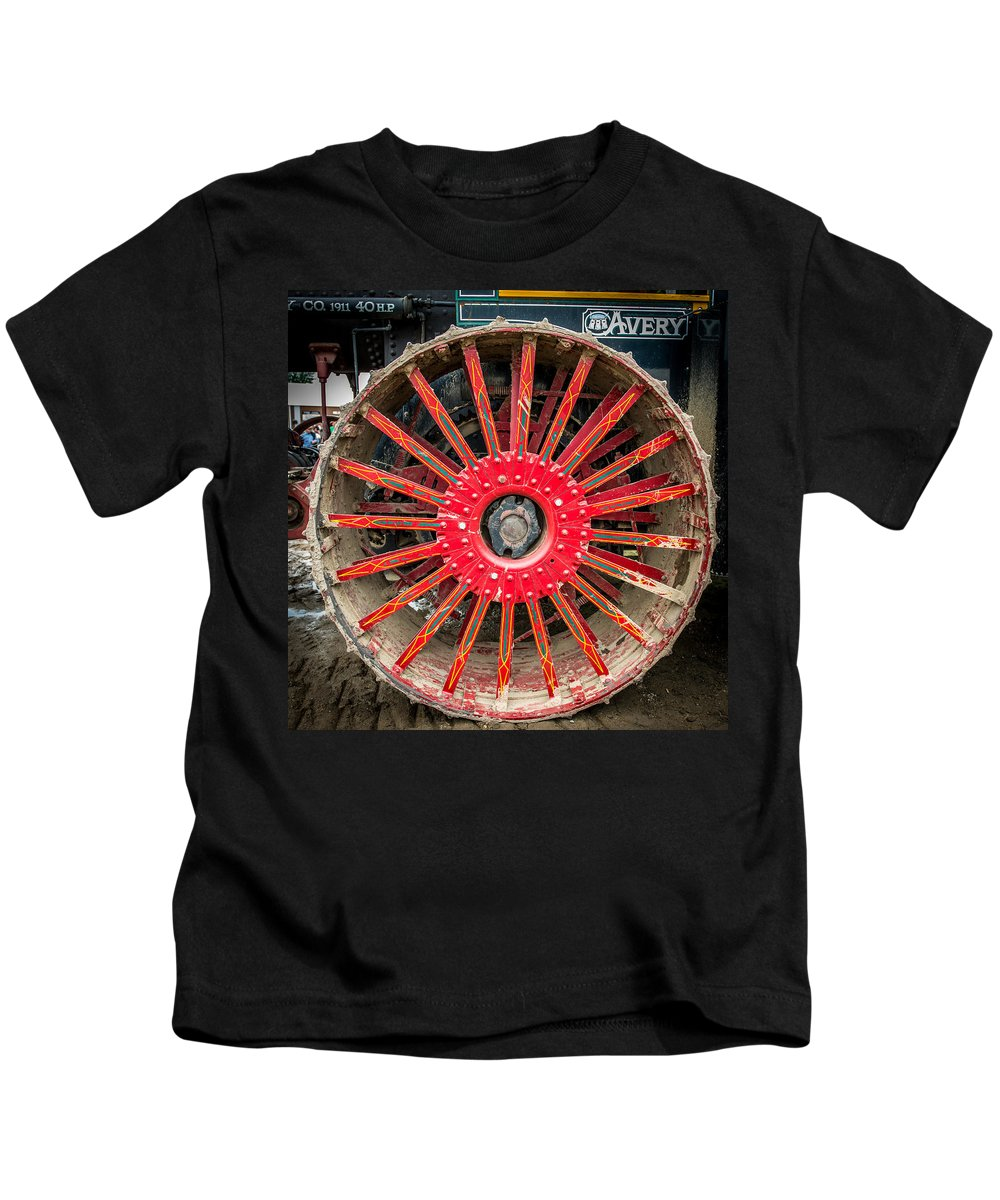 Teeth Kids T-Shirt featuring the photograph Avery Tractor Tire by Paul Freidlund