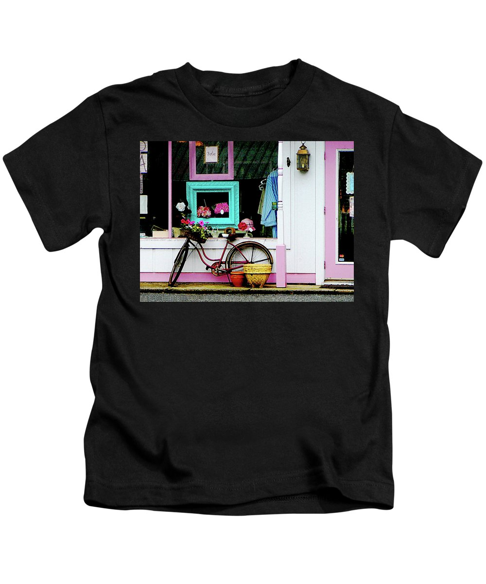 Bicycle Kids T-Shirt featuring the photograph Bicycle By Antique Shop by Susan Savad