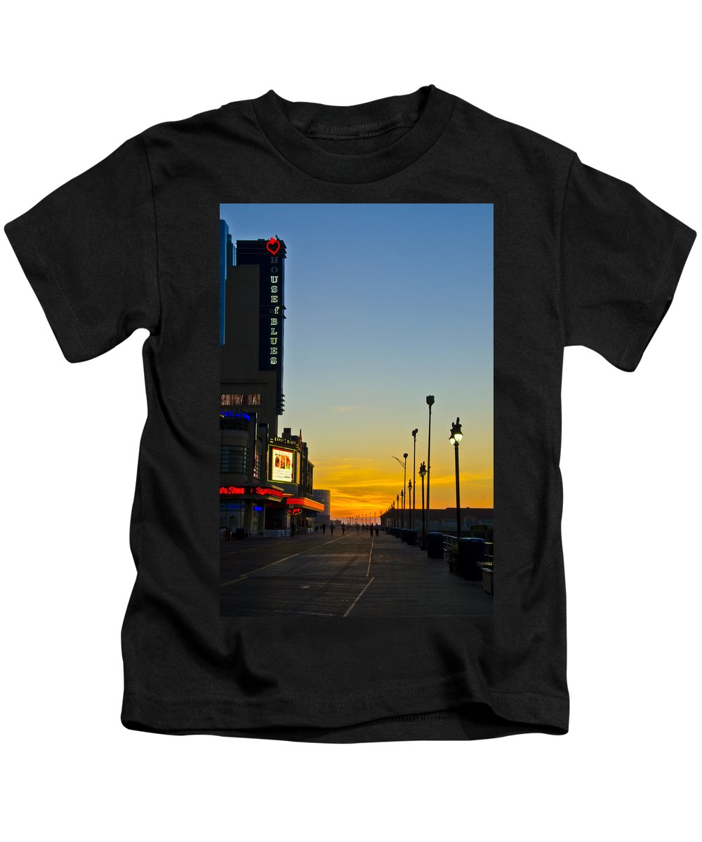 Boardwalk Kids T-Shirt featuring the photograph Boardwalk House Of Blues At Sunrise by Bill Cannon