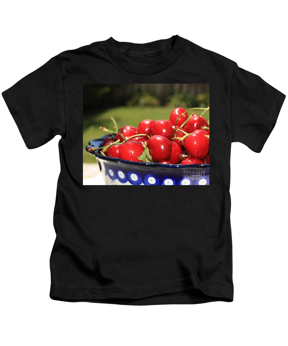 Cherries Kids T-Shirt featuring the photograph Bowl Of Cherries In The Garden by Carol Groenen
