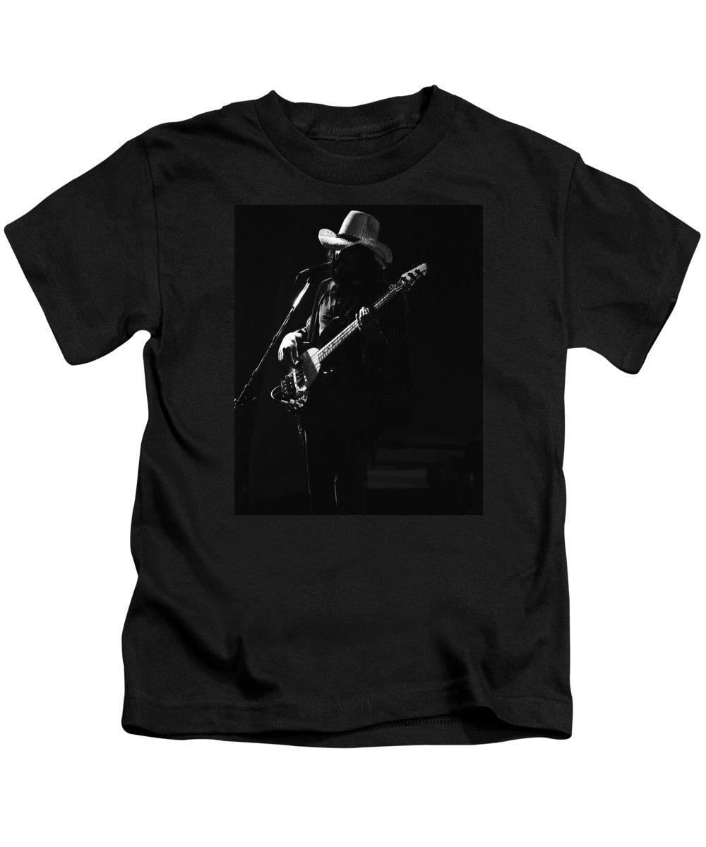 Boz Burrell Kids T-Shirt featuring the photograph Boz On The Bass Guitar 1977 by Ben Upham