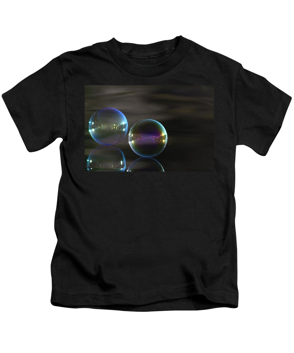Bubbles Kids T-Shirt featuring the photograph Bubble Bubble On The Water by Cathie Douglas