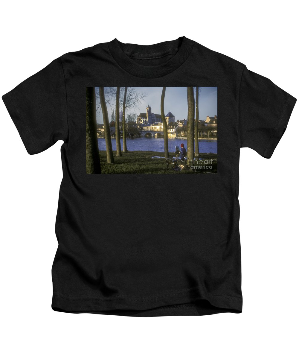 Moret Sur Loing France Boy Boys Child Children Person People Persons City Cities Building Buildings River Rivers Water Artist Church Churches Landscape Landscapes Cityscape Cityscapes Waterscape Waterscapes Kids T-Shirt featuring the photograph Budding Artist by Bob Phillips