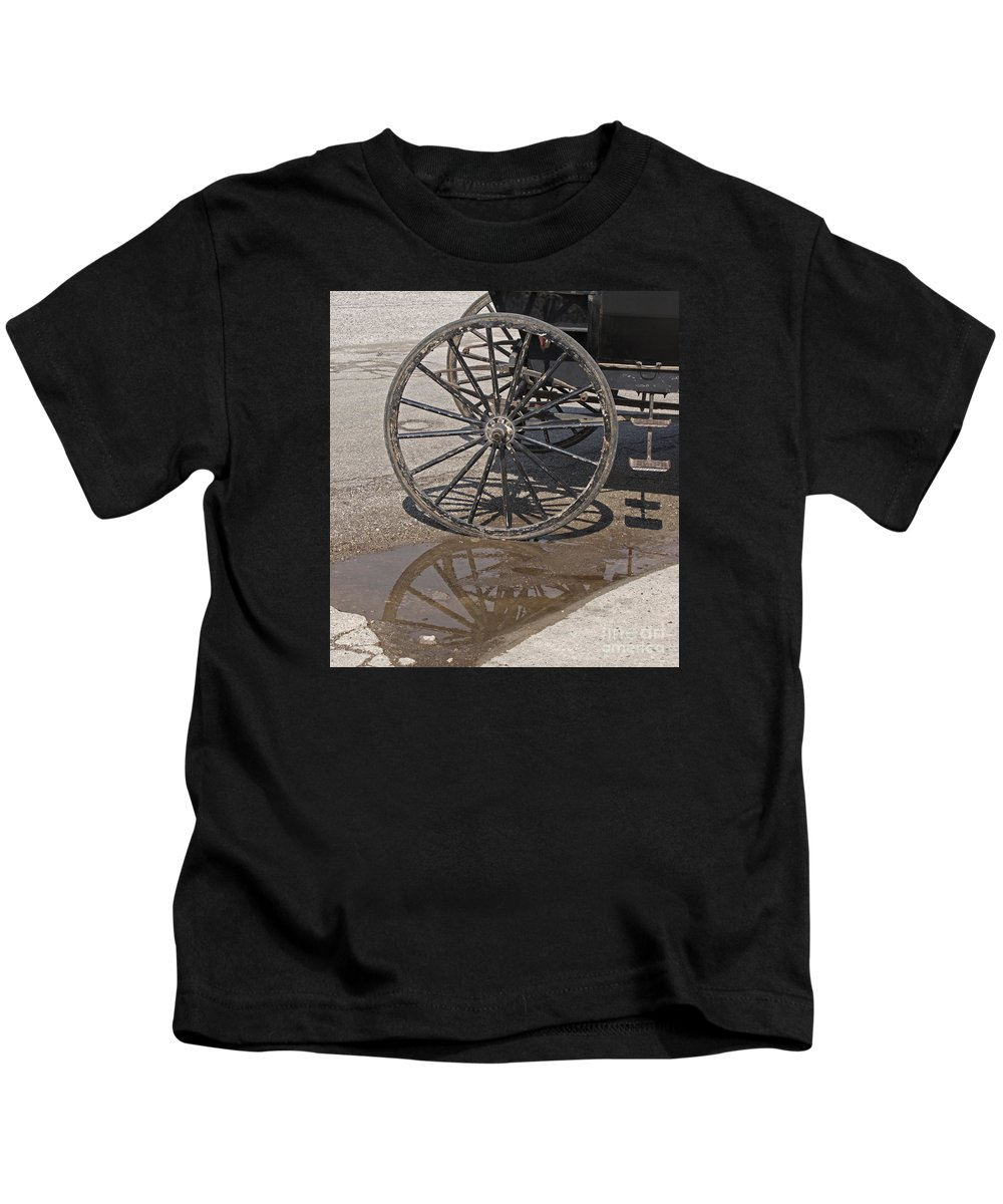 Amish Kids T-Shirt featuring the photograph Buggy Wheels by Ann Horn